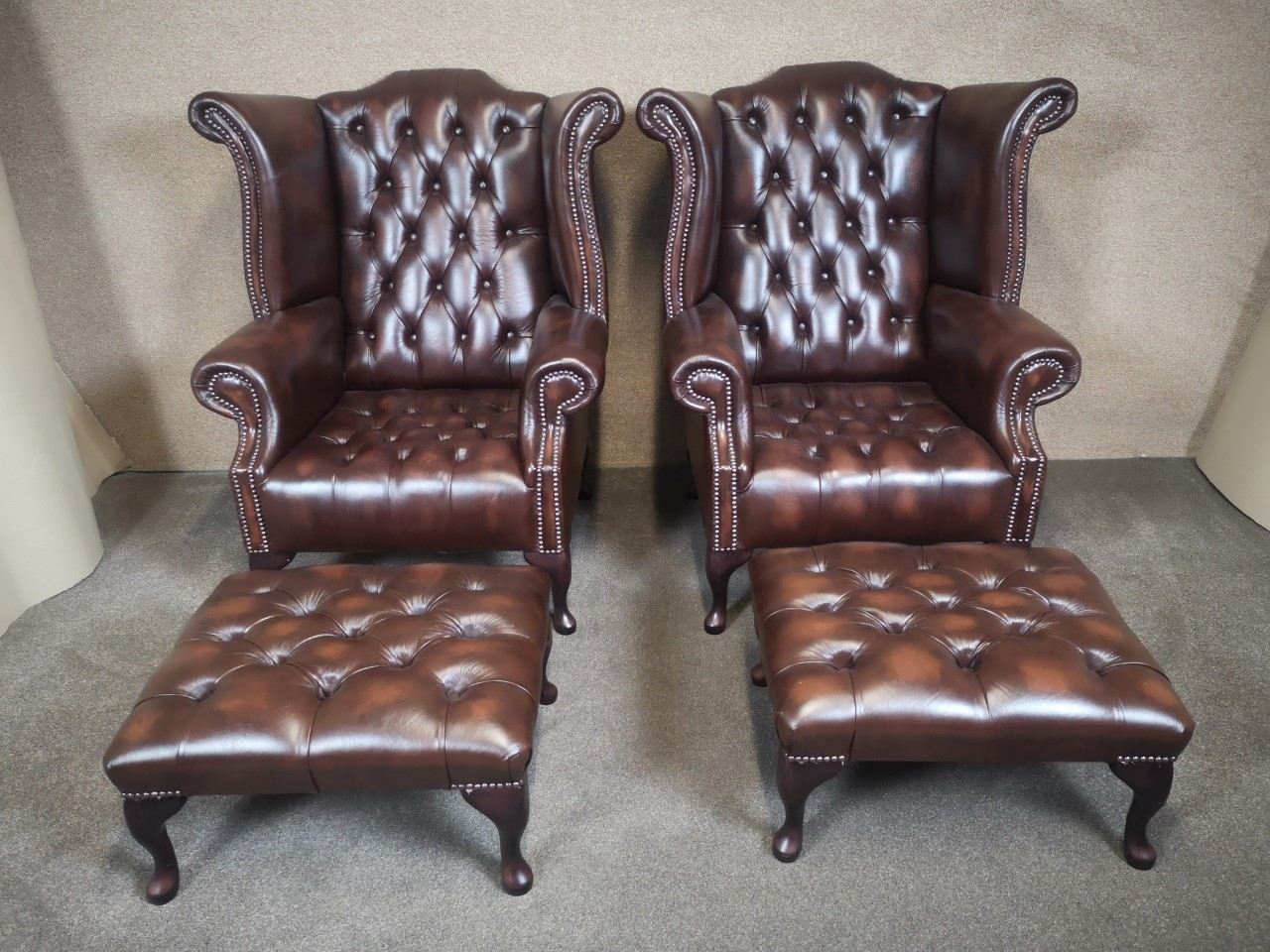Pair of brown leather chairs with matching stools(stools)画像